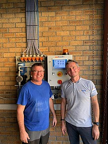 Matthew Parkinson and Steven Champion in front of one of six new EASY S systems